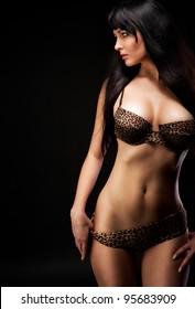 woman in leopard linergie over dark