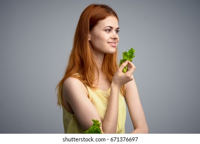 Woman with lettuce leaves