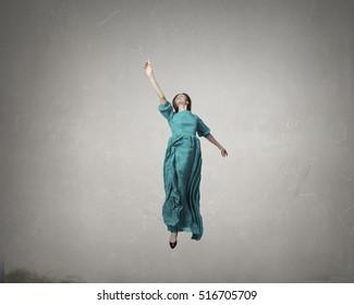 Woman levitating in air . Mixed media