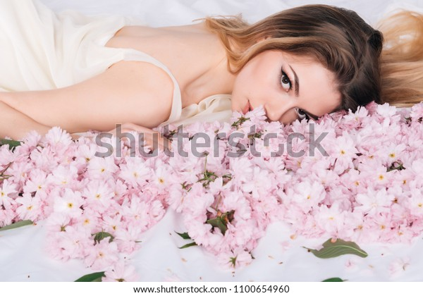 Woman Lieing Bed Covered By Flower Stock Photo (Edit Now