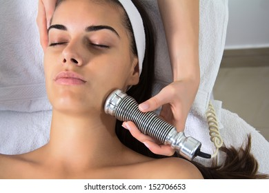 Woman lies in a beauty spa getting a treatment with ultrasonic