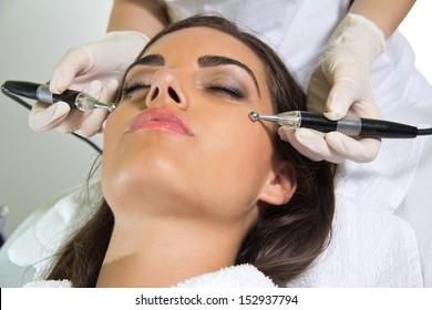 Woman lies in a beauty spa getting a treatmen