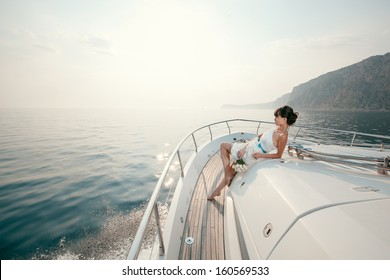 woman lies on a luxury yacht in the sea and looking to the horizon