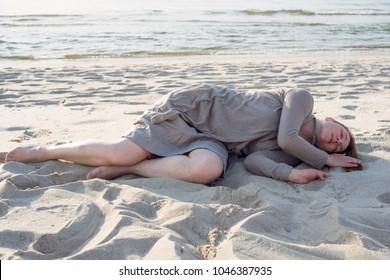 Woman lies on the sand near the sea