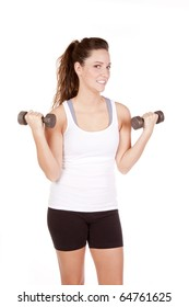 A woman is lifting some weights and wearing shorts and a tank top.