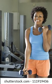 Woman lifting weights at a gym