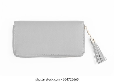 Woman light gray purse isolated on the white background. Closeup of modern ligh gray leather wallet over white background. Top view on the wallet.