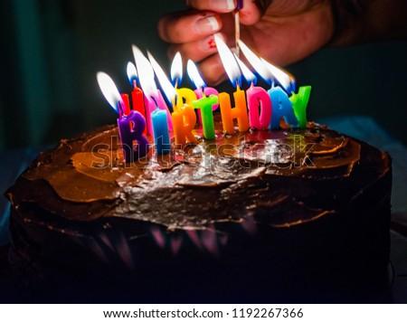 A Woman Lights Up Birthday Cake