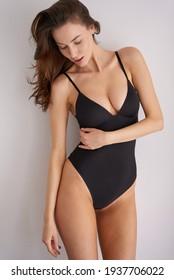 Woman in lingerie looking down