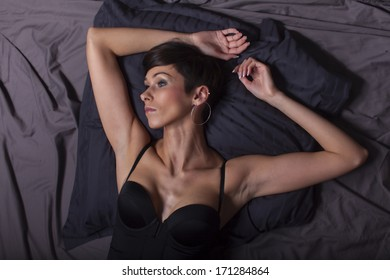 woman in lingery in bed