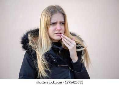 Woman with lip problems outside in winter