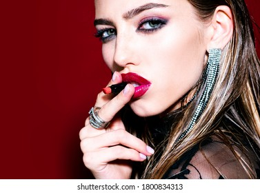 Woman lips. Macro with beautiful girl mouth. Lip care and protection. Sensual portrait young femele model applying or wearing lipstick