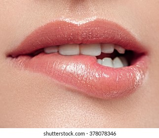 Woman lips mouth biting lip