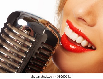 woman lips singing with retro microphone
