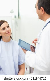 Woman listening to a doctor in an examination room