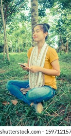 woman listening to music with earphones in nature.