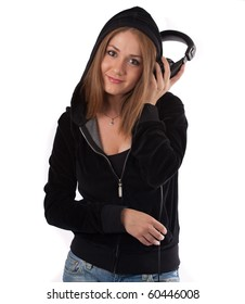 Woman listening to music at a  headphone smiling ,isolated on white