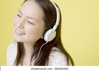The woman listening to music on headphones