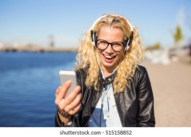woman listening to music on her smartphone