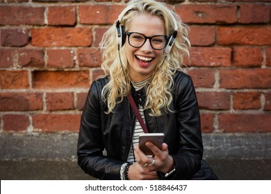 Woman listening music on her headphones