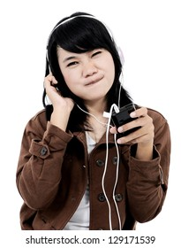 Woman listening to music with the phone and having fun, isolated on white background