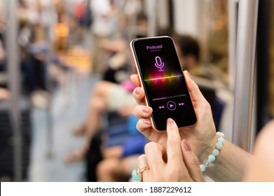Woman listening to podcast on her phone while riding in public transport
