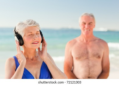 Woman listening to some music at the beach