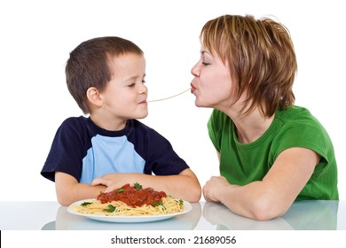Woman and little boy eating  spaghetti - isolated
