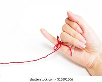 赤い糸 小指の写真素材画像写真 Shutterstock