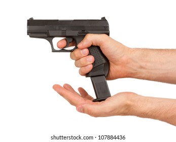 Woman loading a black gun, isolated on white
