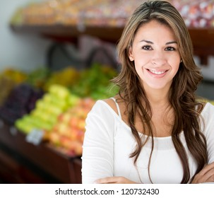Woman at the local market looking happy
