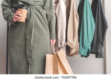 Woman locating near racks in shop