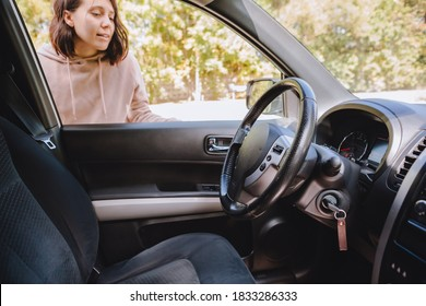 woman locked car and forget keys inside - Shutterstock ID 1833286333