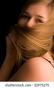 Woman with long hair blowing in her face