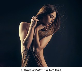 Woman with long hair and naked chest. Hairdresser concept. Woman with very long hair. Beauty hair salon. Haircare and shampoo. Portrait of beauty with beautiful healthy long hair.