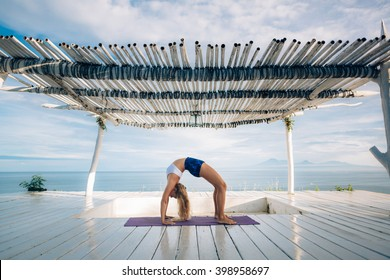 Woman With Long Hair And Slim Body Make Morning Yoga Exercise On The Yoga  Mat On