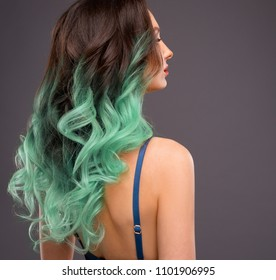 Woman with Long Healthy Colorful Mint Ombre Wavy Hair. Close Up of Hairstyle. Care and Hair Products