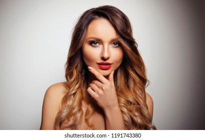 Woman with Long Healthy Colorful Ombre Wavy Hair and Perfect Make up. Close Up of Hairstyle. Care, Hair, Cosmetics Products