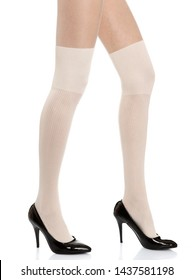 Woman with long legs wearing white stylish panty hose stockings and black high heels steps to the right side on white isolated background_2