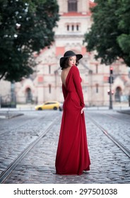 Woman in the long red dress looking back