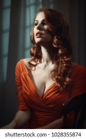 Woman with long red hair - dramatic cinematic lighting