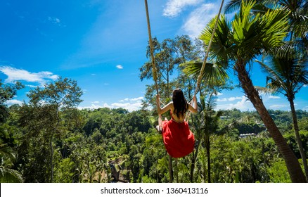 woman with long swing and forest view