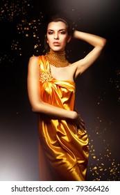 woman in long yellow dress