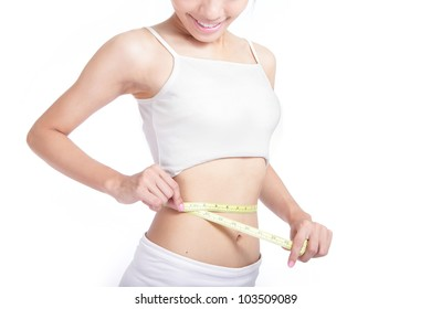 Woman look her body and measuring shape of beautiful waist with smile for Healthy lifestyles concept isolated on white background, model is a asian beauty