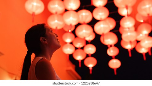 Woman look at the red lantern for Chinese new year