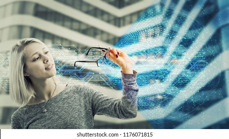 Woman look through eyeglasses and see a new world. Modern type of glasses, technological upgrade, artificial intelligence futuristic concept. Change the boring world to colorful virtual reality.