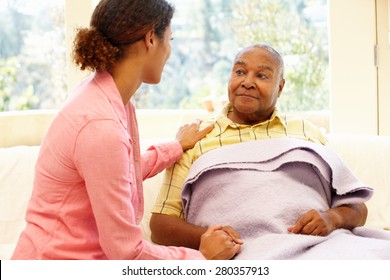 Woman looking after sick father