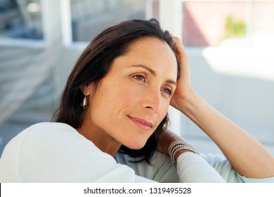woman looking away - beautiful pensive middle aged person - close up portrait