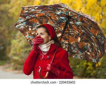 Woman looking away and cover her face