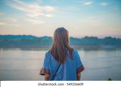 Woman looking away , River Background